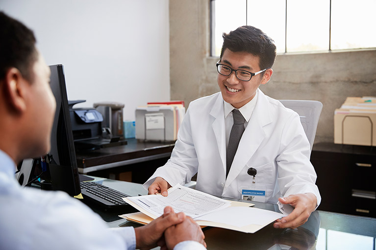 happy-asian-male-doctor-in-consultation